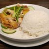 Hainanese chicken with cucumber and rice meal